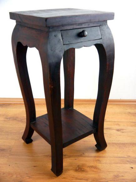 eleganter opiumtisch in schwarz mit schnitzerei im inneren